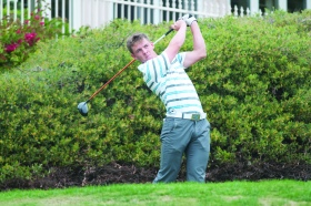 Junior golf team member Grant Forrest tees off in a competition earlier this season. Forrest, who has received several conference recognitions this year, was most recently selected to compete in the NCAA Regional Competition, which could lead to a chance to compete in the NCAA Championships.