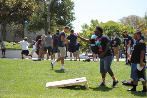 Students next to the Plaza de San Diego enjoy Associated Students' new Get on the Grass initiative.