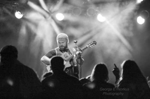 Lead singer Zac Brown sports his signature beanie hat as he performs on the guitar.