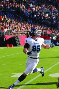 Redshirt sophomore tight end Ross Dwelley looks into the sun to find the ball. Photo Courtesy of Ian Lituchy/The Vista